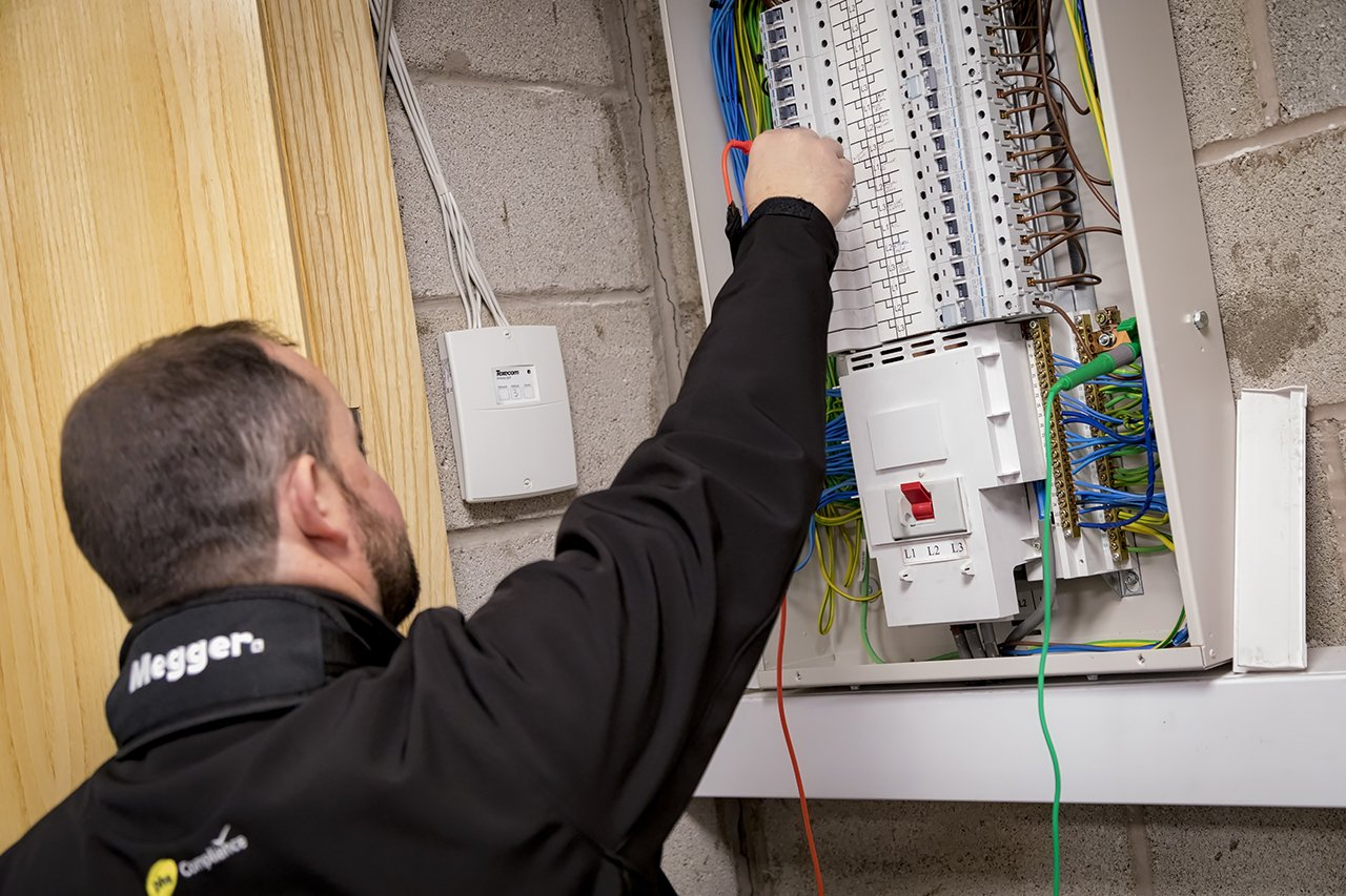 engineer testing distribution board as part of electrical installation inspection (fixed wire)  by phs Compliance