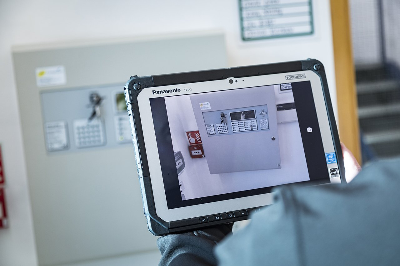 fire alarm panel viewed through an asset capture tablet as part of a fire risk assessment carried out by phs Compliance